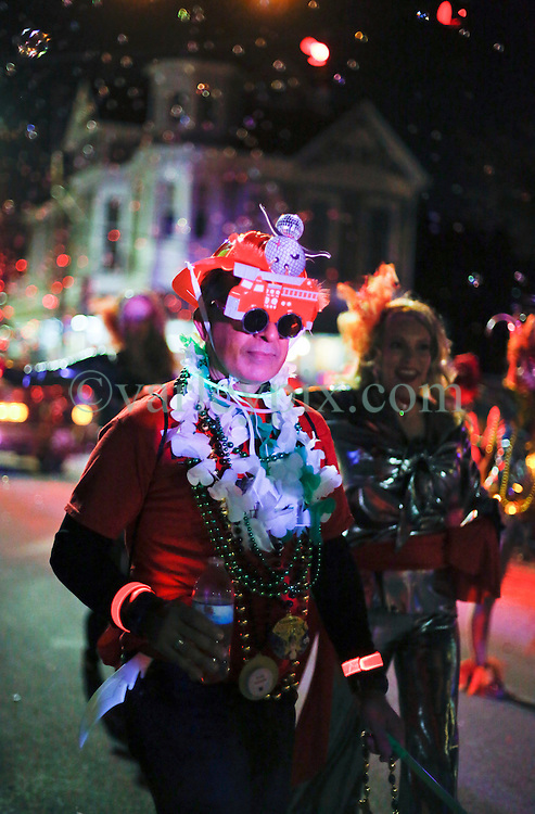29 January 2016. New Orleans, Louisiana.<br /> The Krewe of Cleopatra kicks off the main parading season of Mardi Gras in New Orleans with floats filled with riders dispensing beads and throws, marching bands and dance troupes. Families line the streets Uptown to cheer on Cleopatra - 'Throw me something Mister!'<br /> Photo©; Charlie Varley/varleypix.com