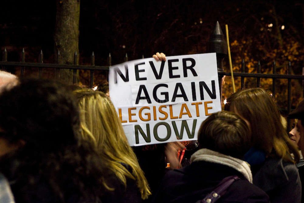 """Protesters attend a vigil outside at the Irish embassy in Brussels on November 21st following the tragic death Savita Halappanavar on October 28. The gathering was organised for Irish citizens abroad and other nationalities to show their solidarity with women in Ireland, and to call on the Irish government to take action on abortion and women's right to choose. <br /> <br /> Savita Halappanavar, was 17 weeks pregnant and miscarrying when she died in Galway University Hospital Ireland, after being denied an abortion, and reportedly told that """"Ireland is a Catholic country"""" A 1992 ruling in the Supreme Court of Ireland in 1992 - known as the X case - means terminations are allowed under certain circumstances, where """"a pregnant woman's life was at risk because of pregnancy, including the risk of suicide""""<br /> <br /> Sativa's case has caused widespread outrage and protest in Ireland, and has caused widespread reaction worldwide, particularly in India and the UK. In 2009, the European Court of Human Rights found that Ireland had violated the European Convention on Human Rights by failing to provide accessible and effective procedures for women to establish whether they qualify for legal abortions under current Irish laws. The case was due to be considered by an Irish government-appointed group in late 2012. <br /> <br /> © 2012 Dave Walsh"""