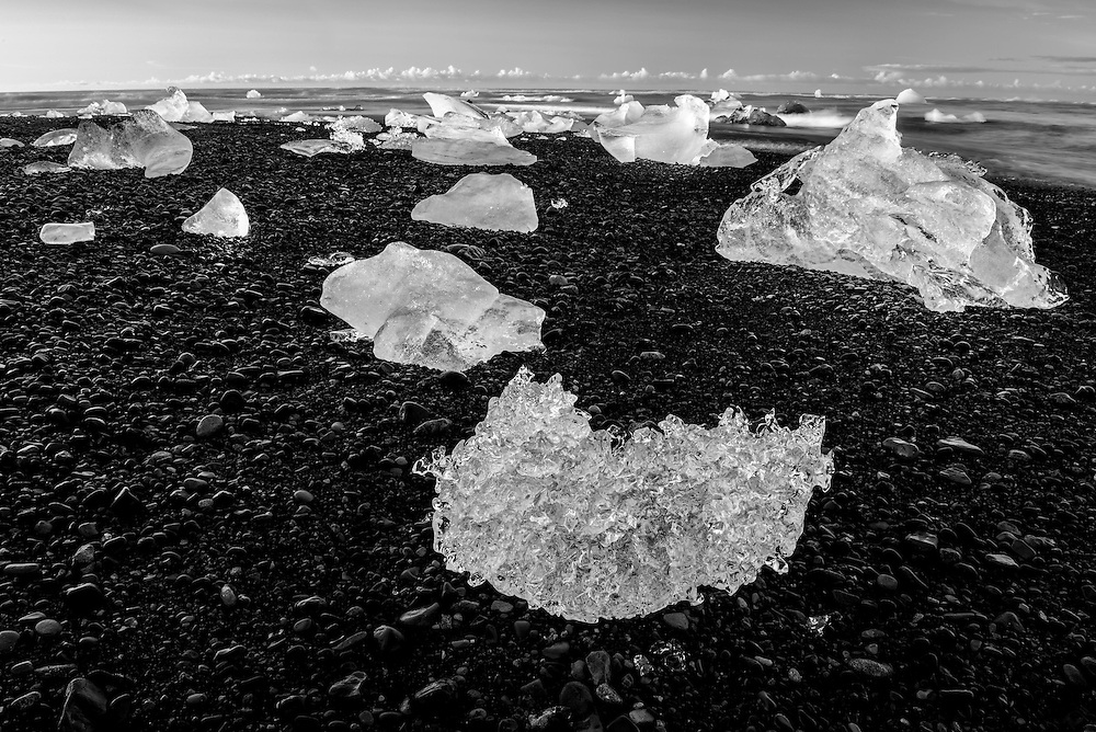 A large group of ice chunks washed ashore on Jokulsarlon black sand beach.