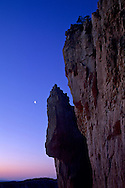 Crescent moon at dawn, next to a hoodoo, Bryce Canyon National Park, UTAH