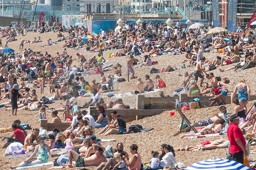 © Licensed to London News Pictures. 25/05/2020. Brighton, UK. Thousands of people take to the beach in Brighton and Hove as sunny and hot weather is hitting the seaside resort on the May Bank Holiday Monday. Photo credit: Hugo Michiels/LNP