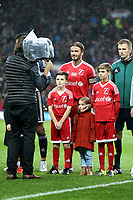David Beckham with Romeo, Cruz and Harper ahead of the Match for Children in aid of Unicef between Great Britain XI v Rest of World XI played at Old Trafford, Manchester on 14th November 2015. Photo Paul Greenwood / Backpage Images / DPPI