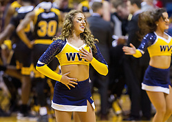 Dec 23, 2016; Morgantown, WV, USA; A West Virginia Mountaineers dance team member performs during a timeout during the first half against the Northern Kentucky Norse at WVU Coliseum. Mandatory Credit: Ben Queen-USA TODAY Sports