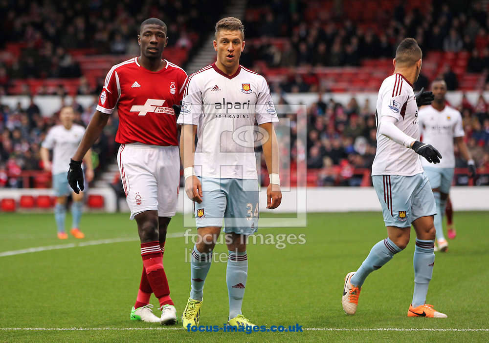 Picture by Tom Smith/Focus Images Ltd 07545141164<br /> 05/01/2014<br /> George Moncur (centre) of West Ham United during the The FA Cup match at the City Ground, Nottingham.