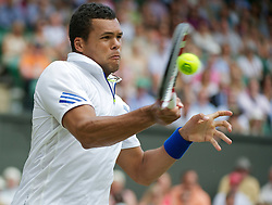 29.06.2011, Wimbledon, London, GBR, ATP World Tour, Wimbledon Tennis Championships, im Bild Jo-Wilfried Tsonga (FRA) in action during the Gentlemen's Singles Quarter-Final match on day nine of the Wimbledon Lawn Tennis Championships at the All England Lawn Tennis and Croquet Club. EXPA Pictures © 2011, PhotoCredit: EXPA/ Propaganda/ David Rawcliffe +++++ ATTENTION - OUT OF ENGLAND/UK +++++