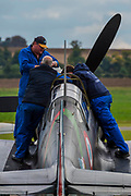 Engineers work on a plane - Duxford Battle of Britain Air Show taking place during IWM (Imperial War Museum) Duxford's centenary year. Duxford's principle role as a Second World War fighter station is celebrated at the Battle of Britain Air Show by more than 40 historic aircraft taking to the skies.