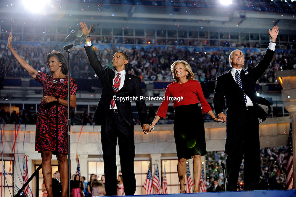 U.S. Senator Barack Obama, Michelle Obama, Jill Biden, and U.S. Senator Joe Biden wave to the crowd after Obama gave his acceptance speech to become the Democratic party's candidate for president August 28, 2008 in Denver, Colorado