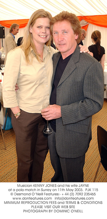 Musician KENNY JONES and his wife JAYNE at a polo match in Surrey on 11th May 2003.PJK 115