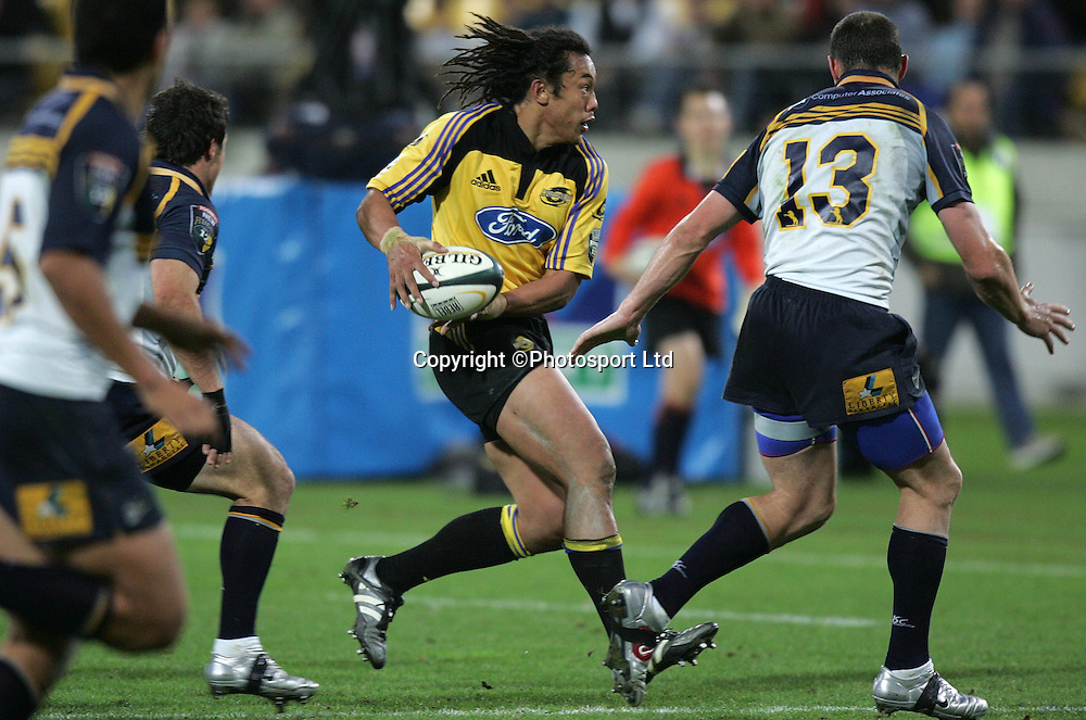 Hurricane's captain Tana Umaga in action during the Hurricane's 49-37 win over the Brumbies in their Super 12 match at the Westpac Trust Stadium in Wellington New Zealand on Saturday night. 30 April 2005 Photo: Marty Melville/Photosport