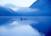 Canoeing on Buntzen Lake early morning, blue
