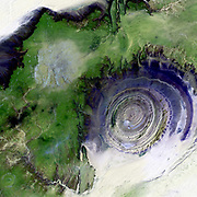 The so-called Richat Structure is a geological formation in the Maur Adrar Desert in the African country of Mauritania. Although it resembles an impact crater, the Richat Structure formed when a volcanic dome hardened and gradually eroded, exposing the onion-like layers of rock.  2001