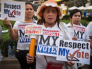 "19 JANUARY 2014 - BANGKOK, THAILAND: Thais gather in Benjasiri Park to pray for peace and support democracy. ""Respect my vote"" has become a rallying cry of people who are concerned their could be a military coup in Thailand. Hundreds of people came to Benjasiri Park, a few hundred meters from the anti-government protest site in Asok Intersection, Sunday evening to pray for peace and rally for a respect for democracy Sunday. The vigil took place a few hours after a two explosive devices, thought to be grenades, were thrown at the protest site near Victory Monument, several kilometers north of Asok. The grenade attack Sunday was the 2nd daytime grenade attack in three days on anti-government protestors. No arrests have been made in the incidents.    PHOTO BY JACK KURTZ"