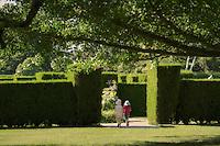 Children entering the garden maze.