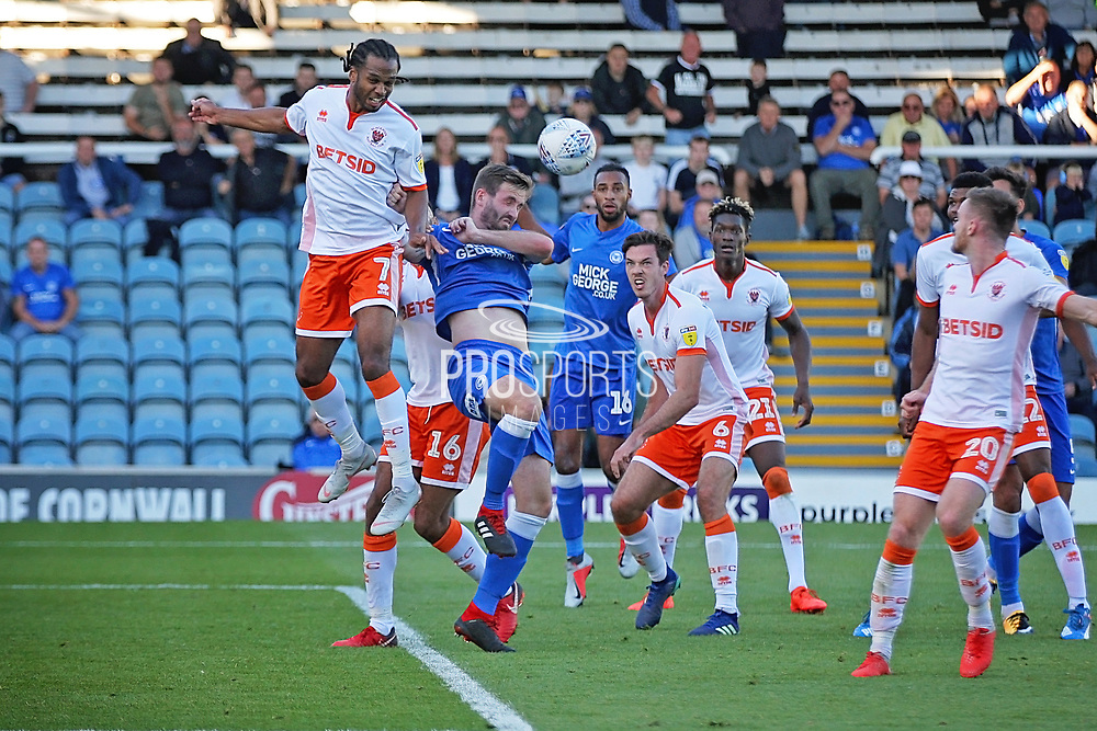 Blackpool forward Nathan Delfouneso (7) gets highest to head this one clear during the EFL Sky Bet League 1 match between Peterborough United and Blackpool at The Abax Stadium, Peterborough, England on 29 September 2018.