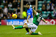 Daniel Candeias (#21) of Rangers plays the ball beyond the outstretched leg of Lewis Stevenson (#16) of Hibernian during the Ladbrokes Scottish Premiership match between Hibernian and Rangers at Easter Road, Edinburgh, Scotland on 19 December 2018.