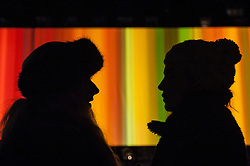 "© Licensed to London News Pictures. 15/01/2016. London, UK.  Visitors silhouetted against ""Spinning Light in Living Colour"" by Elaine Buckholtz on display in Grosvenor Square.  The work forms part of Lumiere London, a major new light festival which is into the second of four evenings and featuring artists who work with light.  The event is produced by Artichoke and supported by the Mayor of London.  Photo credit : Stephen Chung/LNP"