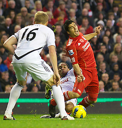 05.11.2011, Anfield Stadion, Liverpool, ENG, Premier League, FC Liverpool vs Swansea City, im Bild Liverpool's Luis Alberto Suarez Diaz is fouled by Swansea City's Ashley Williams  // during the premier league match between FC Liverpool vs Swansea City at Anfield Stadium, Liverpool, EnG on 05/11/2011. EXPA Pictures © 2011, PhotoCredit: EXPA/ Propaganda Photo/ David Rawcliff +++++ ATTENTION - OUT OF ENGLAND/GBR+++++