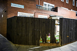 © Licensed to London News Pictures. 20/03/2019. London, UK. Damage to a fence at the rear of a property on Knights Close Hackney, east London where a A 28-year-old man was shot by armed police after reportedly making threats to kill while armed with knives. Photo credit: Ben Cawthra/LNP
