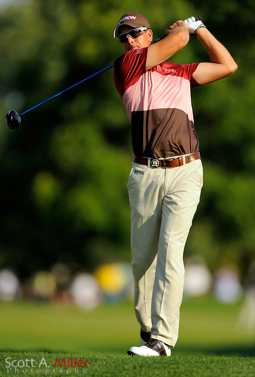 Aug 13, 2009; Chaska, MN, USA; Henrik Stenson (SWE) hits his tee shot on the 12th hole during the first round of the 2009 PGA Championship at Hazeltine National Golf Club.  ©2009 Scott A. Miller