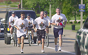 On Lam, owner of Lam's Garden, Ahens, Rick Crossen, Athens City Police, Steve Noftz, Ohio University Police..They run up Richland avenue, as the start of Day 1 of the Law enforcement Torch Run on 6/24/04 which will end at OSP Post 23 on Ety Rd in Lancaster, OH. This event is to raise awareness and money for special olympics