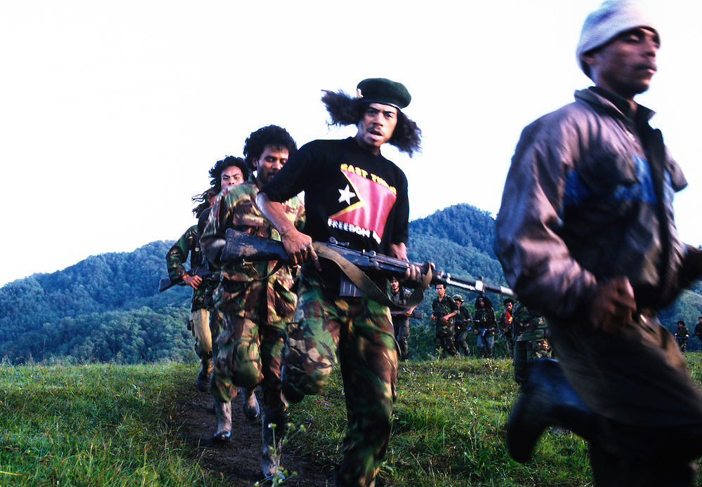 Falintil soldier, during training. <br /> <br /> His revolutionary name is Sarampang, meaning: 'he must catch his enemy and teach him'. <br /> <br /> The Falintil insist that they show compassion to their enemies when they have captured them.  Instead of torturing and killing as the Indonesian military would do, they prefer to lecture them on their ethics and then let them go. <br /> <br /> It has been said that some of the captured Indonesian soldiers have been so impressed by the Falintil morals that they have defected to them.<br /> <br /> East Timor, March 1999.