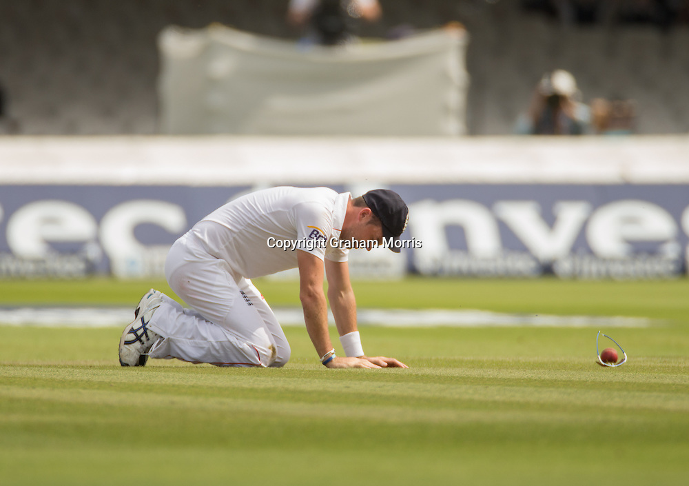 James Anderson drops AB de Villiers off the bowling of Graeme Swann during the third and final Investec Test Match between England and South Africa at Lord's Cricket Ground, London. Photo: Graham Morris (Tel: +44(0)20 8969 4192 Email: sales@cricketpix.com) 19/08/12