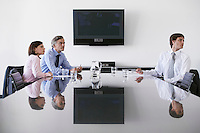 Three business colleagues in conference room