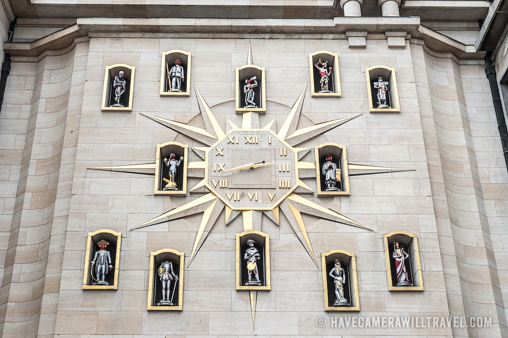 A carillon clock on an overpass in the Mont des Arts in Brussels, Belgium. Each hour is designated a stylized statue.