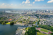 Nederland, Zuid-Holland, Rotterdam, 10-06-2015; Kralingen gezien vanaf de Kralingse Plas, centrum met hoogbouw rechts, de Nieuwe Maas in het verschiet.<br /> Rotterdam Kralingen seen from the Kralingse Plas towards river New Meuse.<br /> luchtfoto (toeslag op standard tarieven);<br /> aerial photo (additional fee required);<br /> copyright foto/photo Siebe Swart