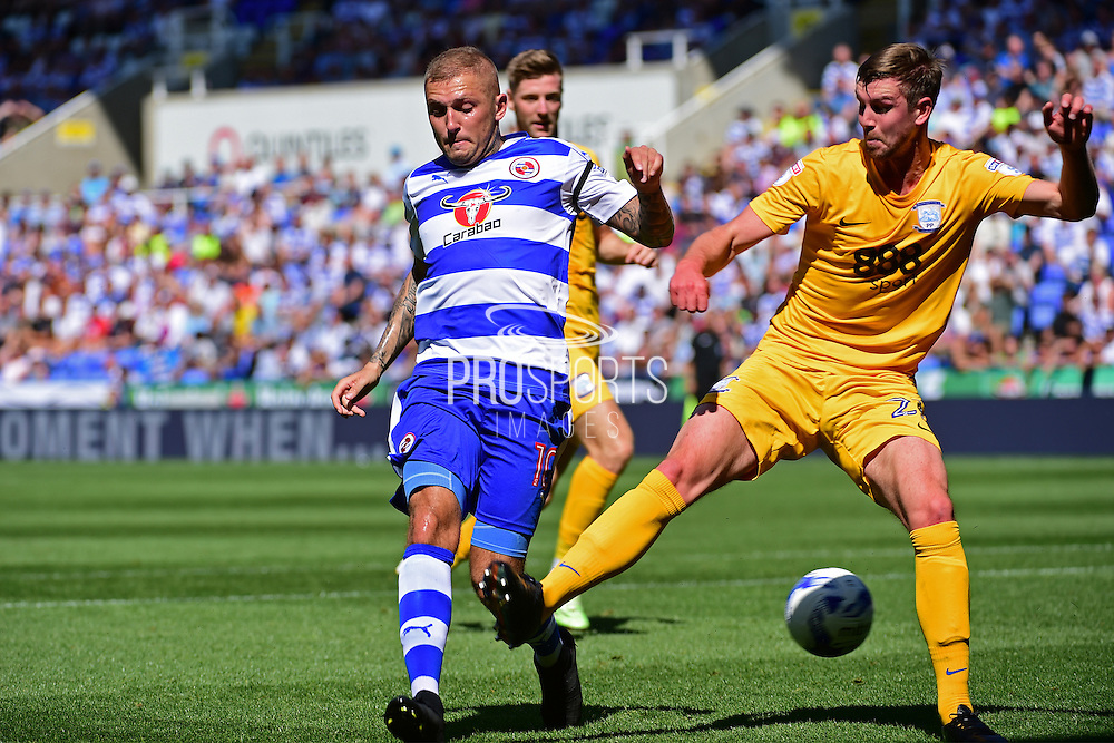 Reading forward Deniss Rakels (10) sneaks a shot past Preston North End defender Paul Huntington (23) during the EFL Sky Bet Championship match between Reading and Preston North End at the Madejski Stadium, Reading, England on 6 August 2016. Photo by Jon Bromley.