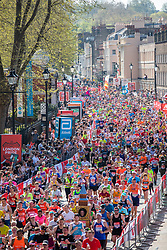 © Licensed to London News Pictures. 22/04/2018. London, UK. Marathon runners pass through Greenwich as they run the Virgin Money London Marathon 2018. Photo credit: Rob Pinney/LNP