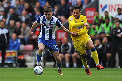Ryan Colclough of Wigan Athletic gets away from Harry Forrester of AFC Wimbledon - Mandatory by-line: Greig Bertram/JMP - 28/04/2018 - FOOTBALL - DW Stadium - Wigan, England - Wigan Athletic v AFC Wimbledon -