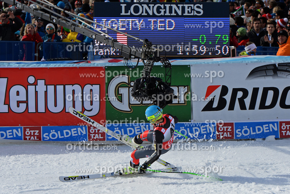27.10.2013, Rettenbachferner, Soelden, AUT, FIS Weltcup, Ski Alpin, Riesenslalom, Herren, Podium, im Bild Ted Ligety from The USA fährt in die TV Kamera nach seinem Siegesjubel // Ted Ligety from The USA gets hit by, tv camera as he celebrates his victoryon podium of mens Giant Slalom of the FIS Ski Alpine Worldcup opening at the Rettenbachferner in Soelden, Austria on 2012/10/27. EXPA Pictures © 2013, PhotoCredit: EXPA/ Mitchell Gunn<br /> <br /> *****ATTENTION - OUT of GBR*****