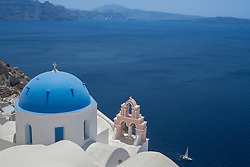 Europe, Greece, Santorini, Ia, Church dome and Aegean Sea, with sailboat