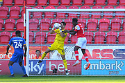 Shrewsbury Town Goal keeper Max O'Leary (25) takes ball clear of Rotherham United player Freddie Ladapo (10) during the EFL Sky Bet League 1 match between Rotherham United and Shrewsbury Town at the AESSEAL New York Stadium, Rotherham, England on 21 September 2019.