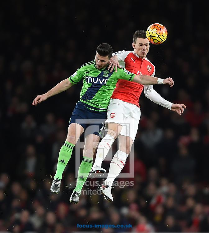 Arsenal's Laurent Koscielny (right) and Southampton's Shane Long battle during the Barclays Premier League match at the Emirates Stadium, London<br /> Picture by Daniel Hambury/Focus Images Ltd +44 7813 022858<br /> 02/02/2016
