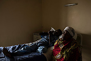 Christine Mukanzayirambaho, 16, waits with her mother, Joseline Nyirandihoreye, during the pre-operation period at King Faisal Hospital in Rwanda. Ms. Mukanzayirambaho needed her heart's mitral valve replaced.<br /> <br /> Rheumatic heart disease is damage to one or more heart valves that stems from inadequately treated strep throat. Left untreated, rheumatic heart disease leads to heart failure.