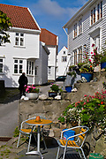 Old and traditional white houses in the beautiful city of Skudeneshavn on Karmöy, western Norway.