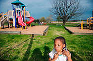 "Kodie Brown plays at the local playground, near RFK Stadium. Kodie's mother was fatally shot by her father while trying to escape onto a Metro bus. Kodie, who was grazed by a bullet in the attack, needs several operations to remove more facial scar tissue. ""No baby should have to go through what she has gone through,"" said Deborah Alessi, who has helped set up a foundation that pays for victims of domestic violence to have plastic surgery. (Amanda Voisard, for The Washington Post )"