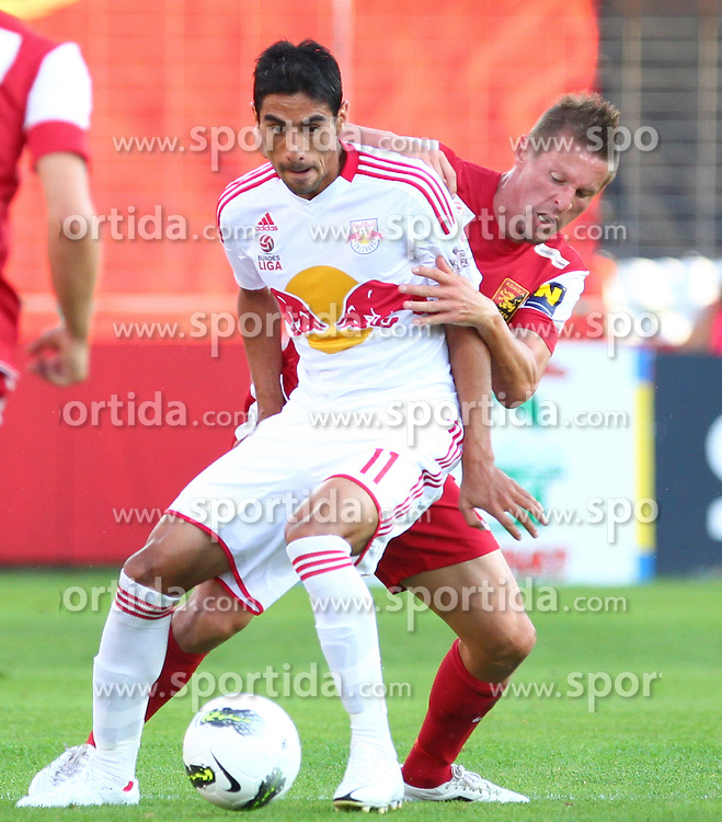 18.08.2012, Trenkwalder Arena, Maria Enzersdorf, AUT, 1. FBL, FC Admira Wacker Moedling vs FC Red Bull Salzburg, im Bild Gonzalo Zarate, (Red Bull Salzburg, #11) und Gernot Plassnegger, (FC Admira Wacker Moedling, #4)  // during Austrian Bundesliga Football Match, round 1, between FC Admira Wacker Moedling vs FC Red Bull Salzburg at the Trenkwalder Arena, Maria Enzersdorf, Austria on 2012/08/18. EXPA Pictures © 2012, PhotoCredit: EXPA/ Thomas Haumer
