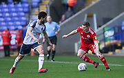 Joe Pritchard of Accrington(right) and Bolton Wanderers Jason Lowe in action with during the EFL Sky Bet League 1 match between Bolton Wanderers and Accrington Stanley at the University of  Bolton Stadium, Bolton, England on 29 February 2020.