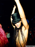 Clubber in a top hat and necklace of beads Ibiza 1999