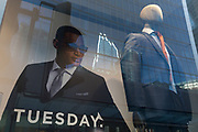 With the UK death toll reaching 34,813, with a further 541 victims in the last 24hrs, the government's pandemic lockdown has eased to another stage and shop mannequins stand in the window of a menswear retailer with corporate offices in the background of the City of London, the capital's financial district, on 1st June 2020, in London, England.