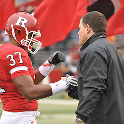 Dec 5, 2009; Piscataway, NJ, USA; Rutgers head coach Greg Schiano shakes hands with FB Andres Morales during the senior ceremony before first half NCAA Big East college football action between Rutgers and West Virginia at Rutgers Stadium.
