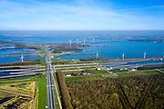 Nederland, Noord-Brabant, Willemstad, 01-04-2016; Volkeraksluizen, in de voorgrond rechts het speciaal aangelgde bos. Midden de schutsluizen met drie kolken, daarachter, onder de brug van de A 29, de spuisluizen. Daar achter de de jachthaven met een vierde sluis, voor de pleziervaart. Op het Knooppunt Hellegatsplein splitst de snelweg, naar links de N 59, naar Goeree-Overflakkee via de Hellegatsdam, naar rechts de A29 naar de Haringvlietbrug. De Volkeraksluizen - in de Volkerakdam - verbinden het Hollandsch Diep met het Volkerak en maken deel uit van de Deltawerken.<br /> Volkerak Locks, largest inland navigation locks in Europe, part of the Deltaworks.<br /> luchtfoto (toeslag op standard tarieven);<br /> aerial photo (additional fee required);<br /> copyright foto/photo Siebe Swart