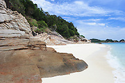 Rocks on a tropical island beach, Pulau Redang, Malaysia <br />