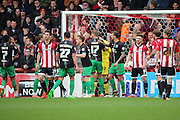 Brentford striker, Scott Hogan (9) after missing a penalty saved by Bristol City goalkeeper, Richard O'Donnell (12) during the Sky Bet Championship match between Brentford and Bristol City at Griffin Park, London, England on 16 April 2016. Photo by Matthew Redman.
