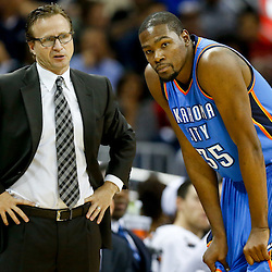 Dec 2, 2014; New Orleans, LA, USA; Oklahoma City Thunder head coach Scott Brooks talks with forward Kevin Durant (35) during the second quarter of a game against the New Orleans Pelicans at the Smoothie King Center. Mandatory Credit: Derick E. Hingle-USA TODAY Sports