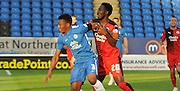 Roarie Deacon and Kgosi Ntlhe battling during the Capital One Cup match between Peterborough United and Crawley Town at London Road, Peterborough, England on 11 August 2015. Photo by Michael Hulf.