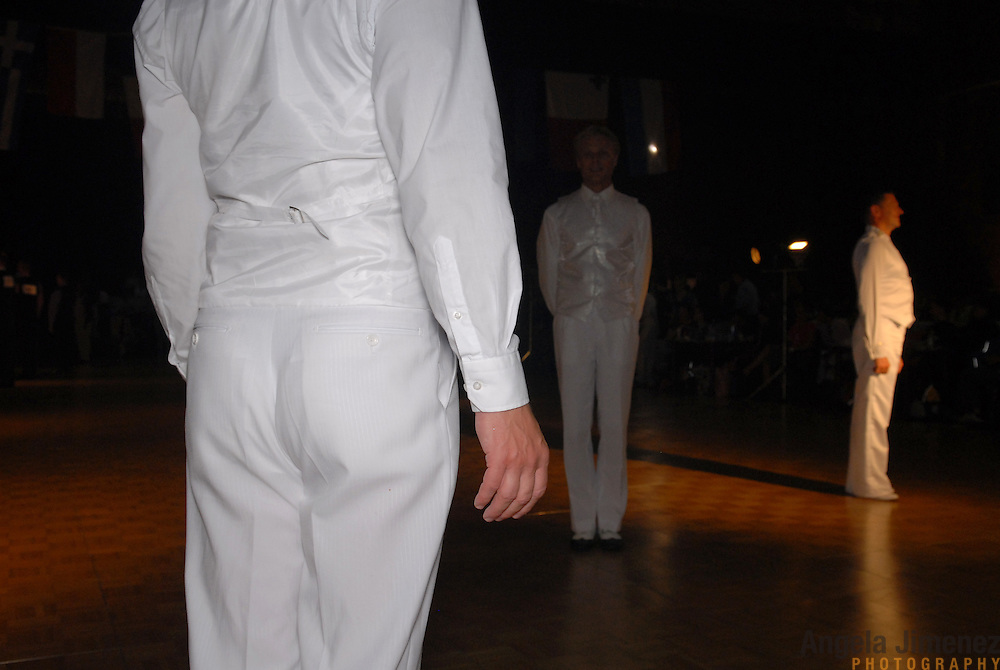 Men compete in the adult men's standard division of the same-sex ballroom dancing competition during the 2007 Eurogames at the Waagnatie hangar in Antwerp, Belgium on July 13, 2007. ..Over 3,000 LGBT athletes competed in 11 sports, including same-sex dance, during the 11th annual European gay sporting event. Same-sex ballroom is a growing sports that has been happening in Europe for over two decades.